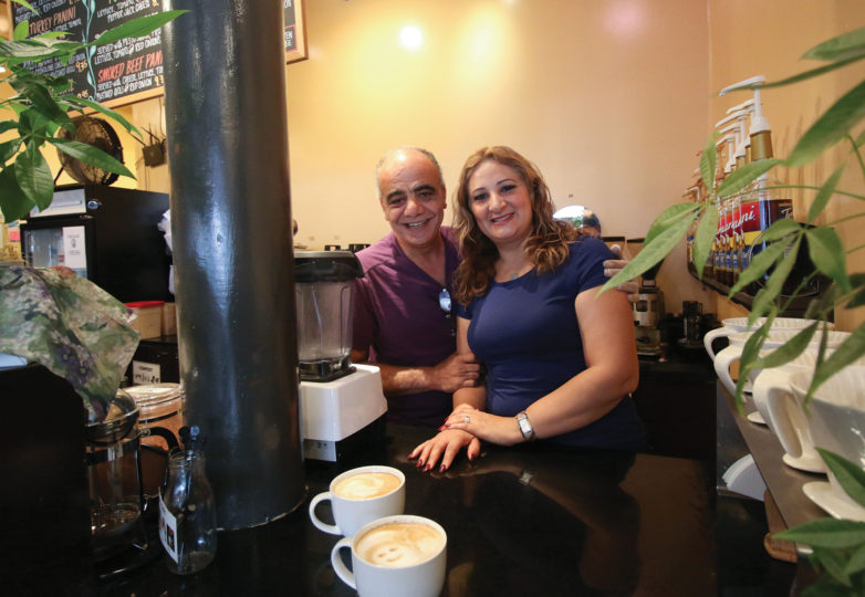 Lamea Abuelrous and her husband Hany work behind the counter at Temo's Café on Sep. 17. Photo: Erica Marquez