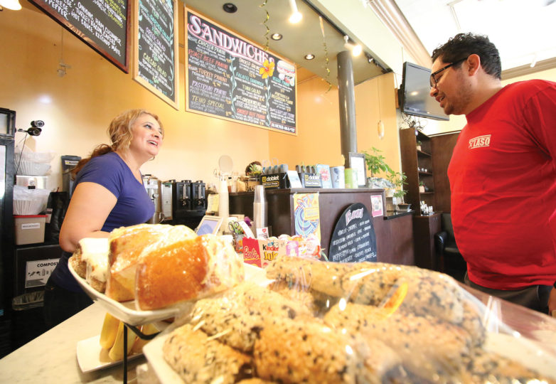 Lamea Abuelrous, owner of Temo's Café serves a customer, Sunday Sept. 17. Photo: Erica Marquez