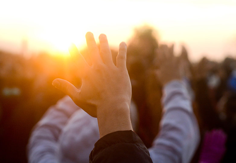 Participants raise their hands in response to the sunrise during the Indigenous People's Sunrise ceremony at Alcatraz, Thursday, Nov. 23, 2017. Photo: Aaron Levy-Wolins