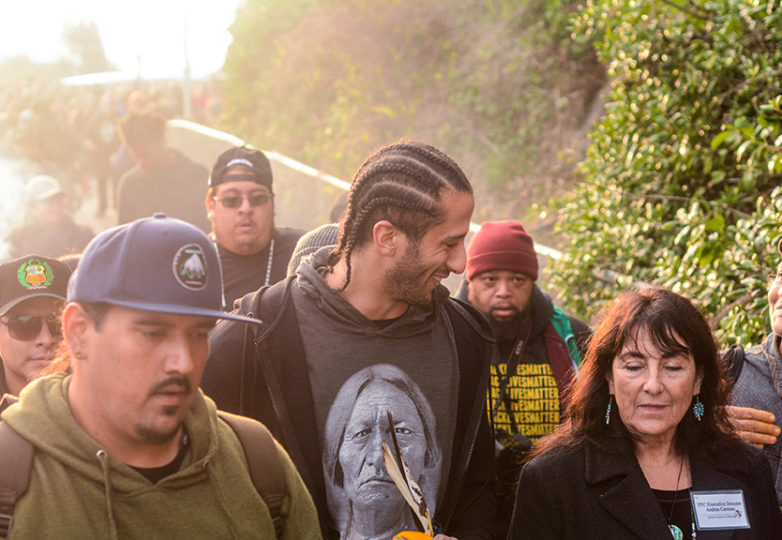 Former San Francisco 49ers quarterback Colin Kaepernick speaks with a participant during the Indigenous sunrise ceremony on Alcatraz island on Nov. 23, 2017. Photo: Aaron Levy-Wolins