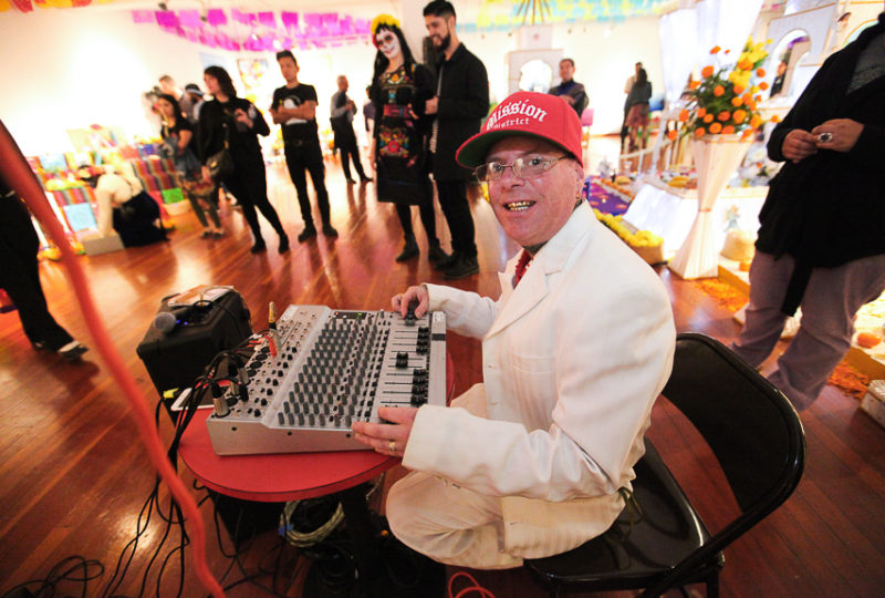 Anastacio works the audio controller during CHHOTI MAA's music performance during the Día de Muertos celebration at Mission Cultural Center on Thursday, Nov. 2, 2017. Photo: Ekevara Kitpowsong