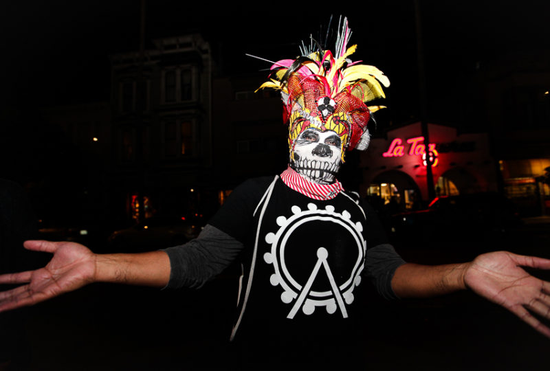 A man poses for a portrait outside the Mission Cultural Center for Latino Arts during the Mission Día de Muertos Celebration, Nov. 2, 2017. Photo: Ekevara Kitpowsong