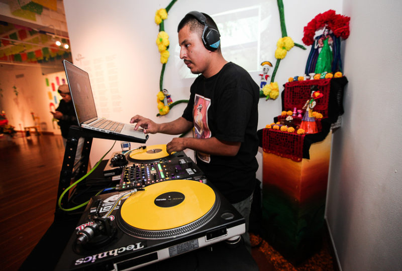 DJ Ozzy at the Día de Muertos  Celebration at Mission Cultural Center, Nov. 2, 2017. Photo: Ekevara Kitpowsong
