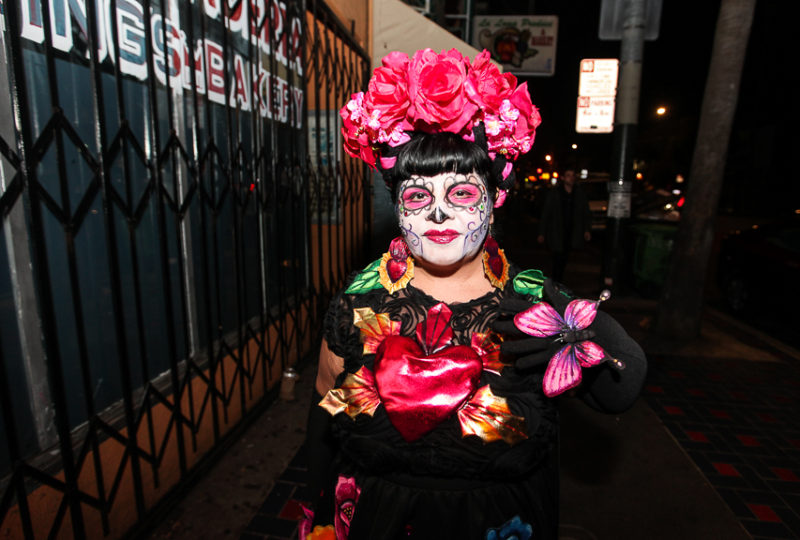 Anita De Lucio walks on Mission street near Mission Cultural Center Día de Muertos Celebration, Thursday, Nov. 2, 2017. Photo: Ekevara Kitpowsong