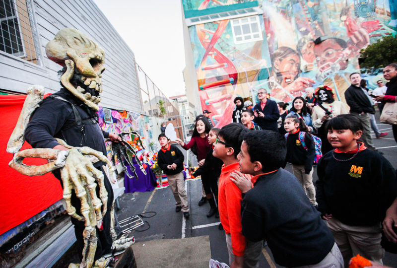 "The ""Skeleton man"" Andres Hernandez Rojo entertains children during ReclaMisión: A Community Dia De Los Muertos Celebration at the Mission Preparatory School, Thursday, Nov. 2, 2017. Photo: Ekevara Kitpowsong"