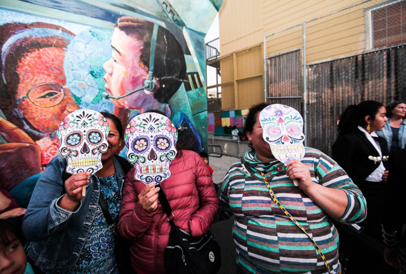 People pose for a portrait during ReclaMisión: A Community Dia De Los Muertos Celebration at the Mission Preparatory School, Thursday, Nov. 2, 2017. (Photo by Ekevara Kitpowsong)