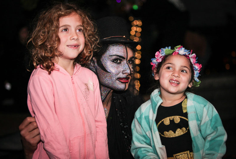 "MC ""Persia""  poses for pictures with children during ReclaMisión: A Community Dia De Los Muertos Celebration, Thursday, Nov. 2, 2017. Photo: Ekevara Kitpowsong"