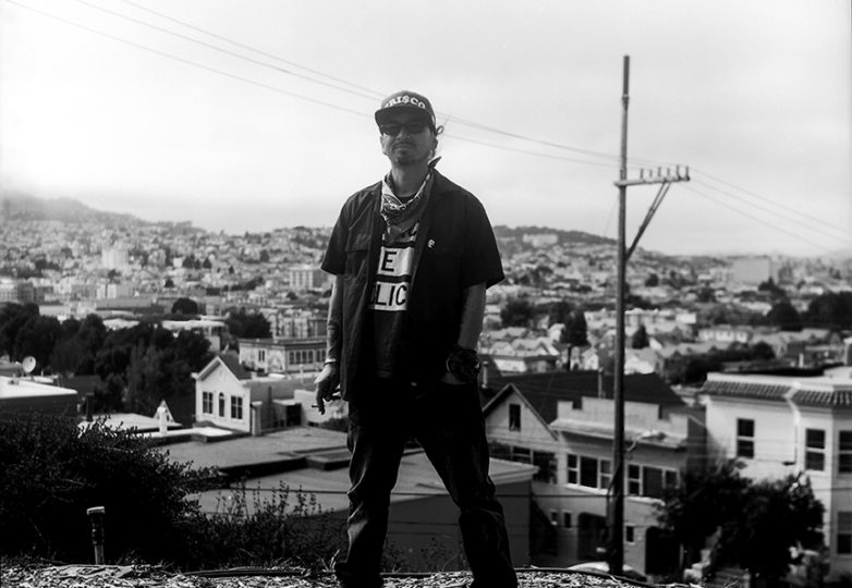 "Ilyich ""Equipto"" Sato poses for a portrait on Dog Hill in the Mission District. Photo: Daniel Valencia"