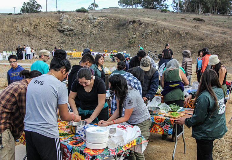 Community members cut vegetables at Community Farm Opening Celebration at Crocker Amazon Park, Nov. 12. Photo: Adelyna Tirado