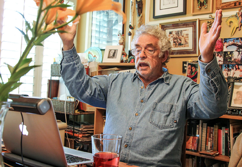 Carlon Baron reads the script he's written for this year's show of La Posarela in his home in Daly City, Calif. on Nov. 14. Photo: Adelyna Tirado