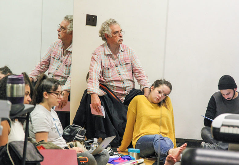 Carlos Baron analyzes the choreography while some of the Bay Area Theater Company (BATCO) crew takes a break at African American Art & Culture Complex in San Francisco, Calif. on Nov. 15. Photo: Adelyna Tirado
