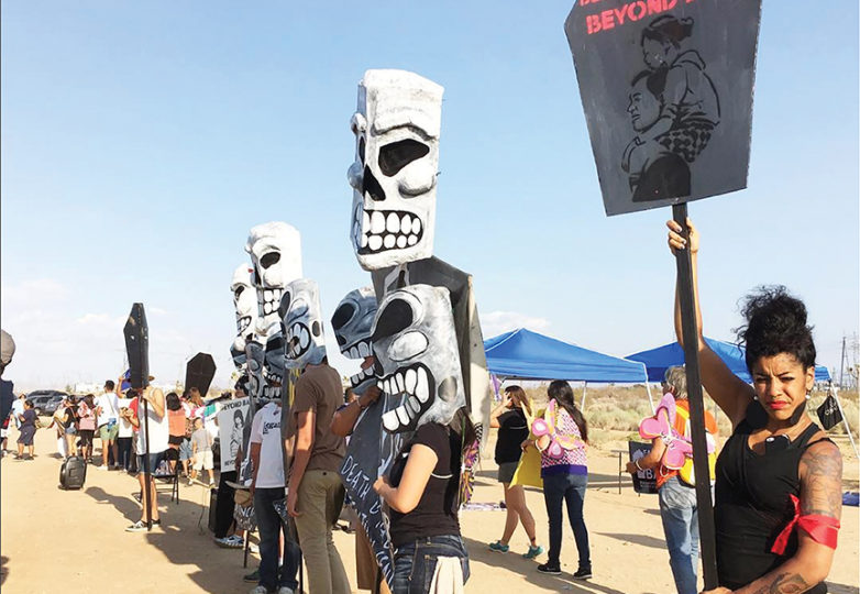 Activists protest outside the Adelanto Immigration Detention Facility in August of 2016. Immigrant rights groups have been calling for the closure of the facility, claiming inhumane treatment of detainees, since as early as 2013. Photo: Jesus Iñiguez/CultureStrike