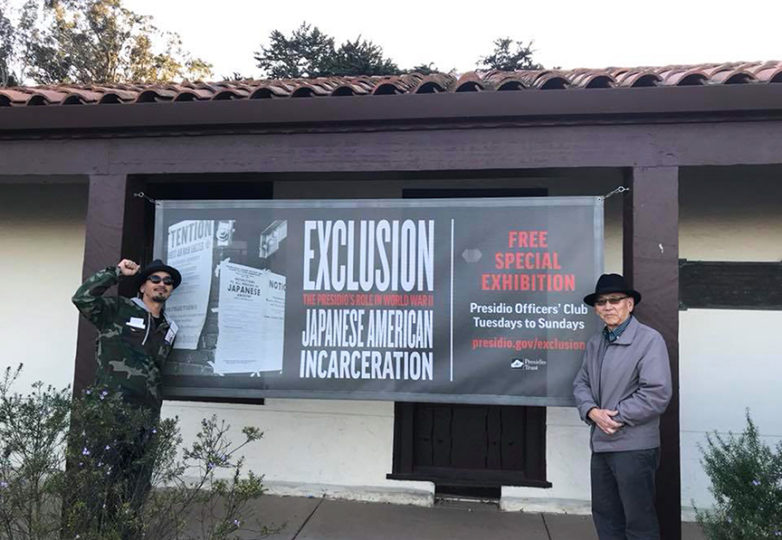 "Local activist-rapper Ilyich ""Equipto"" Sato (left) and his father Art Sato visit the San Francisco exhibit, ""Exclusion: The Presidio's Role in World War II Japanese American Incarceration,"" which opened last on the 75th anniversary of Japanese internment. Courtesy: Art Sato"