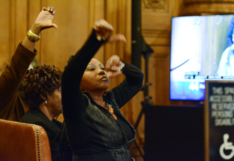 Opponents of acting mayor London Breed give thumbs down signs during public comment a Board of Supervisors meeting at San Francisco City Hall on Jan. 23, 2018. Photo: Aaron Levy-Wolins