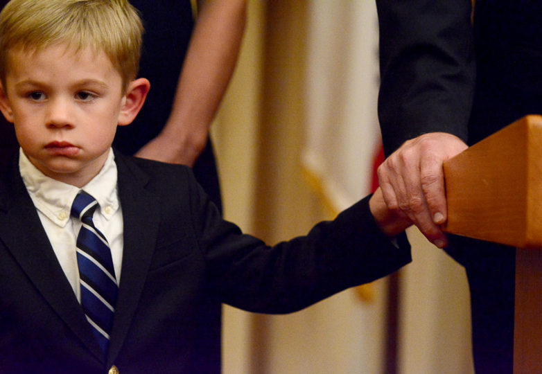 Newly sworn in Mayor Mark Farrell holds his son's hand while on the podium at SF City Hall, Jan. 23, 2018. Photo: Aaron Levy-Wolins