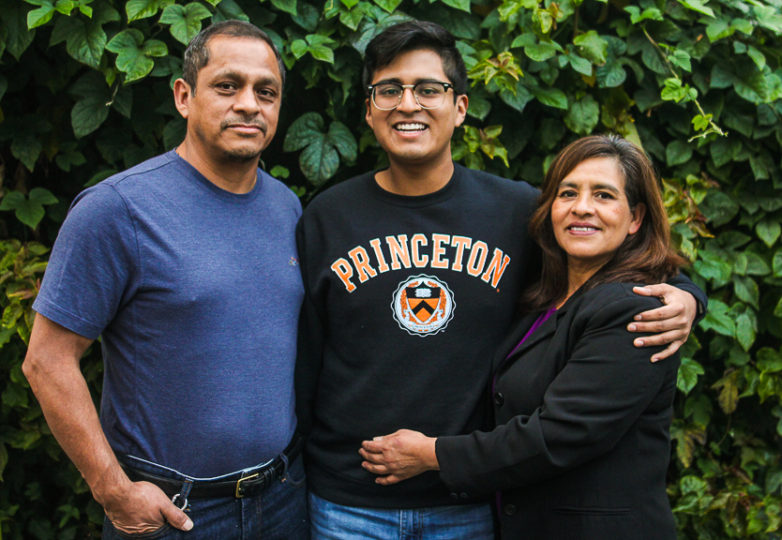 Sergio Martinez Jr. and his parents pose outside of their home in San Francisco on Jan. 4, 2018. Photo: Adelyna Tirado