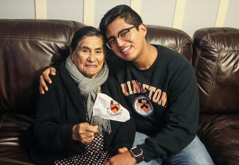 Sergio Martinez Jr. and his grandmother Dorila Romero pose for a portrait showing Princeton spirit in their family home in San Francisco on Jan. 4, 2018. Photo: Adelyna Tirado