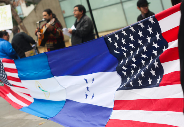 During a Save TPS rally on Jan. 5, 2018, the flags of the United States, Nicaragua and Honduras are stitched together and displayed in front of the San Francisco Federal Building. Photo: Alexis Terrazas