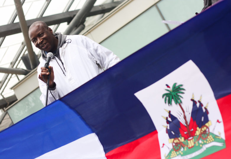 Adoubou Traore, an immigrant from the Ivory Coast, who serves as co-Director of the African Advocacy Network and Executive Director of African Immigrant and Refugee Resource Center (AIRRC) in San Francisco, speaks on behalf Haitians at a Save TPS rally in San Francisco on Jan. 5, 2018. Photo: Alexis Terrazas