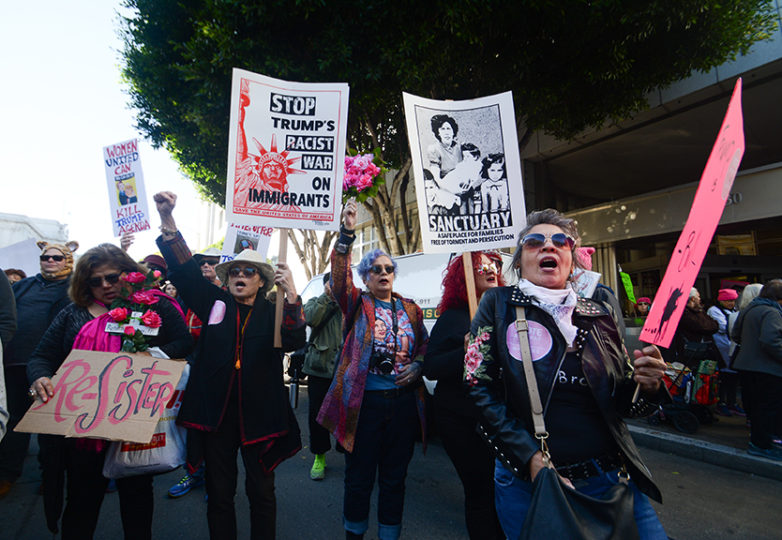 "Irene Araujo ""La Sirena"" (left), Bird Levy (second left), G. Billie Quijano (middle), Ana Guadalupe Aviles (second right), and Valeria Medina march down Market Street in the second annual Bay Area Women's March in San Francisco on Jan. 20, 2018. Photo: Jocelyn Carranza"