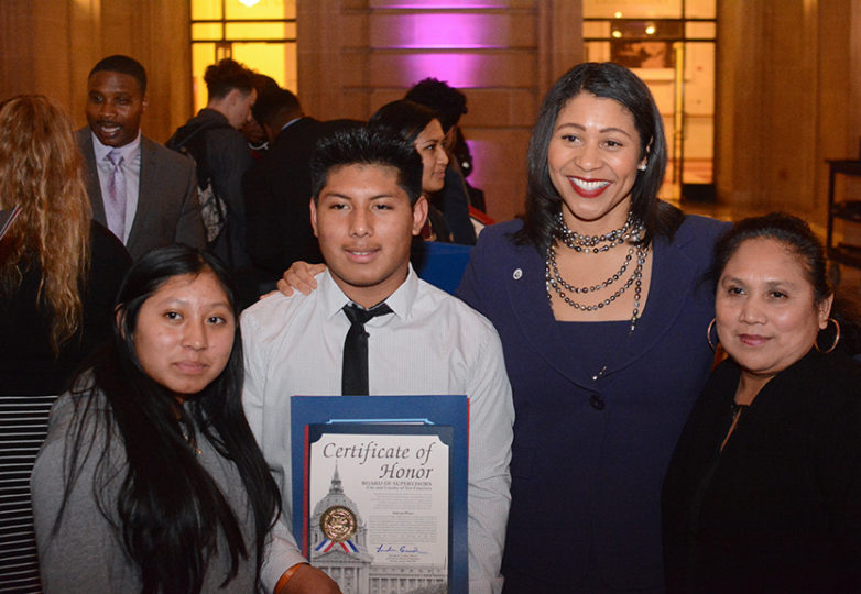 Galileo High School Lions senior quarterback Adrian Poot (#13 – center-left), poses with District 5 Supervisor London Breed (center-right) and his family after the Lions football team is recognized at City Hall on Monday, Jan. 29, 2018. Photo: Aaron Levy-Wolins