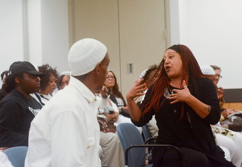 Cat Brooks, a spokesperson for the Anti Police-Terror Project explains the purpose of the BART committee they are responding to at a BART Police Citizen Review Board (BPCRB) meeting in Oakland, Calif. Monday, Mar. 12, 2018.