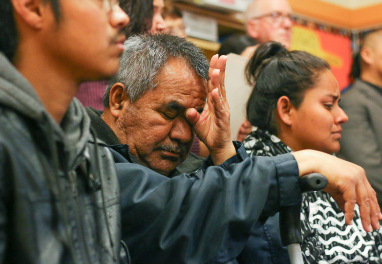 The father of Jesus Adolfo Delgado-Duarte, sits next to his two children at Cesar Chavez Elementary School, where SFPD and community members held a town hall meeting for Delgado-Duarte who was killed by SFPD in the Mission District on March 6, 2018. Photo: Erica Marquez