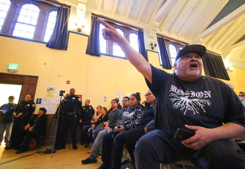 A community member shouts at police during a town hall meeting at Cesar Chavez Elementary School. SFPD held a town hall for community members to discuss the shooting of Adolfo Delgado-Duarte, a 19 year-old man who was killed by police officers on March 6, 2018 in the Mission District. Photo: Erica Marquez