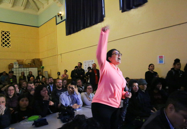 During a tense town hall meeting at Cesar Chavez Elementary School, a woman shouts at the showing of police body cam footage. Police held a town hall to discuss the shooting of Adolfo Delgado-Duarte, a 19 year-old man who was killed by SFPD officers on March 6, 2018 in the Mission District. Photo: Erica Marquez