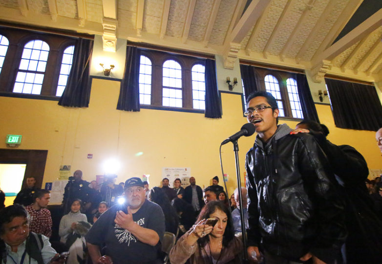Victor Torres, the brother of Adolfo Delgado-Duarte speaks to police during a town hall meeting held at Cesar Chavez Elementary School. SFPD held a town hall for community members to discuss the shooting of Delgado-Duarte, a 19 year-old man who was killed by officers in the Mission District on March 6, 2018. Photo: Erica Marquez