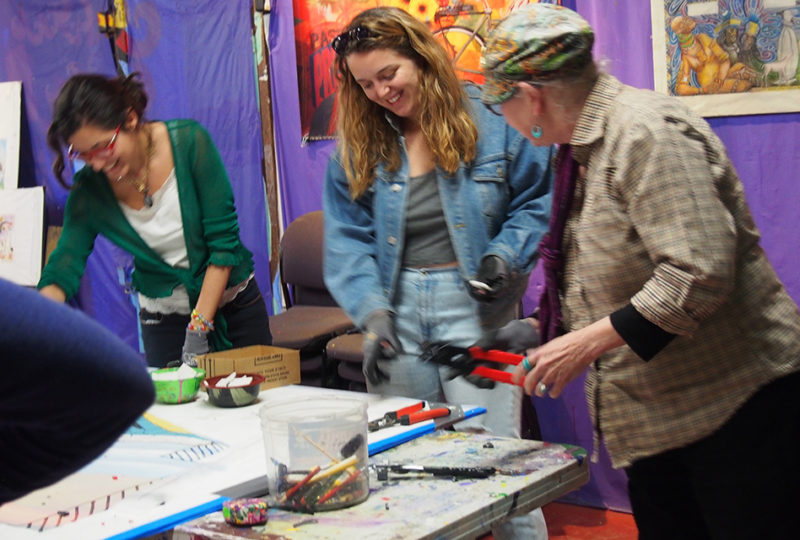 Cervantes and her collaborators laugh while working on her mosaic in the back room of Precita – February 2018. Photo: Ella Ramrayka Rogers
