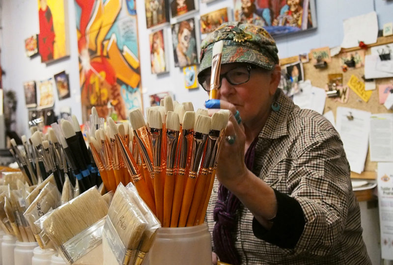 Susan Cervantes arranges brushes after posing for photos – February 2018. Photo: Ella Ramrayka Rogers
