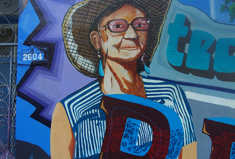 Susan Cervantes depicted in a Precita Eyes mural on 24th and Folsom streets. Photo: Ella Ramrayka Rogers