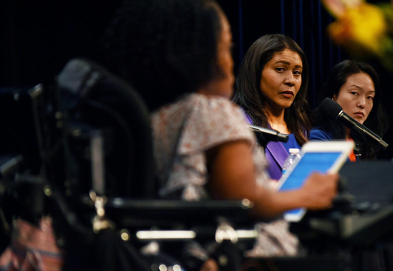 Mayoral candidates London Breed and Jane Kim listen to town hall meeting moderator Yomi Wrong at the Herbst Theatre on April 26, 2018. Photo: Alejandro Galicia Diaz