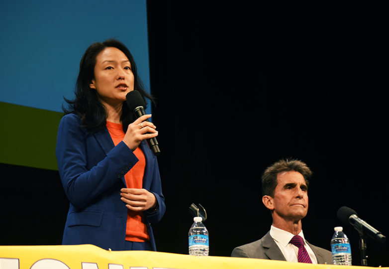 Mayoral candidate Jane Kim makes her closing statement at the mayoral town hall meeting as candidate Mark Leno waits for his turn at the Herbst Theatre on April 26, 2018. Photo: Alejandro Galicia Diaz
