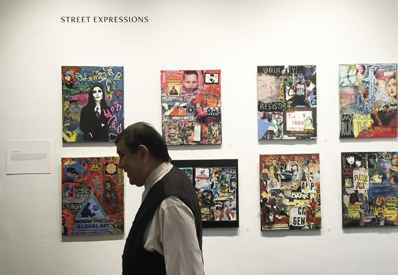 René Yañez walks by his art during a recent exhibit at the Luggage Store Gallery. Photo: Josue Rojas