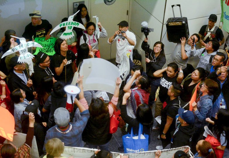 Protesters yell chants at a demonstration at SFO on April 23 against the deportation and alleged torture of Jerome Aba. Photo: Aaron Levy-Wolins