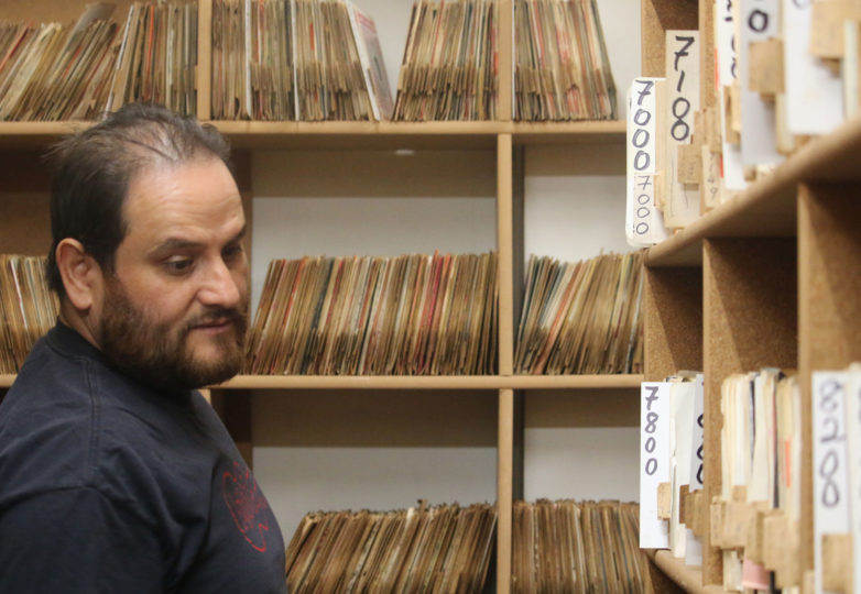 Antonio (Tron) Cuellar browses through the Arhoolie Foundation's Strachwitz Frontera Collection of Mexican and Mexican-American Recordings, which contains nearly 160,000 recordings. To date, Cuellar has digitized more than 130,000 of those recordings. Photo: Kelly Rodriguez-Murillo