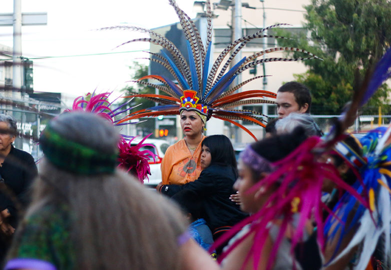 People stand in a circle for the traditional ceremony at Carlos Gutierrez's memorial on Friday July 20 in the Mission District, San Francisco, CA. Photo: Erica Marquez