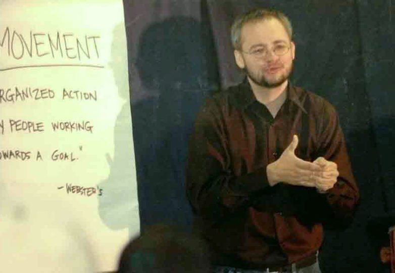 "Drago Rentería, signs the word ""leader"" during a keynote speech he gave at an LGBTQ conference in Seattle in 2006. Photo: Jennifer Mantle"