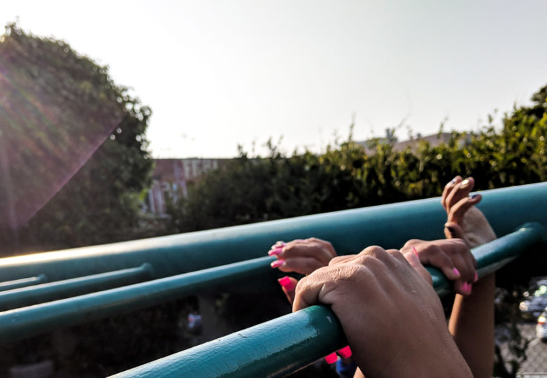 Gaby and her daughter play on a jungle gym at a playground in the  Mission District, July 2, 2018. Photo: Adriana Camarena