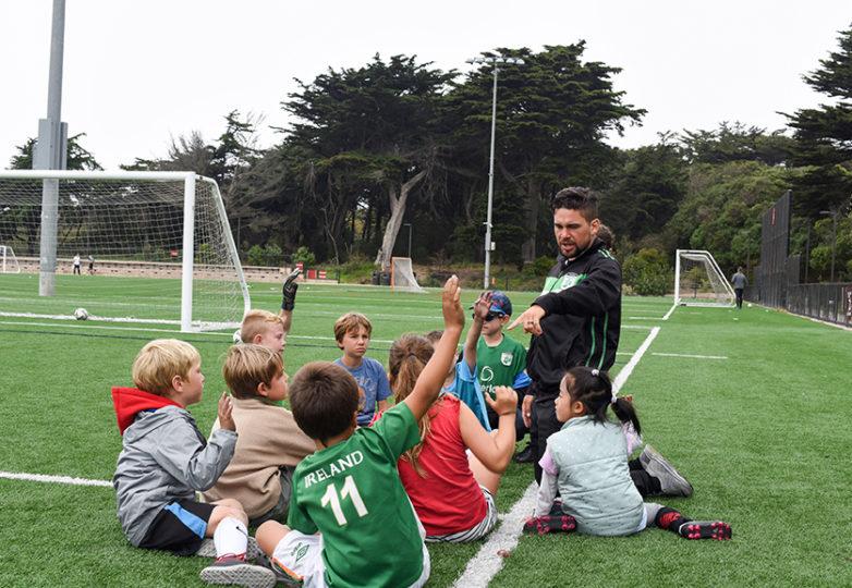 San Francisco Glens' coach Stephen Cordova huddles with his team to discuss practice at Beach Chalet Fields on Aug. 3, 2018. Photo: Alejandro Galicia Diaz