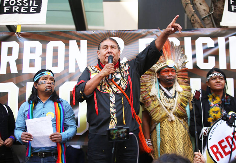 Frontline leaders host a rally in San Francisco on Sept. 10, 2018, hoping to deliver an open letter to Governor Jerry Brown demanding the cancellation of his Climate and Forest Task Force. From left: Marlon Santi, a Kichwa political leader who has served as the national coordinator of Pachakutik, Ecuador's indigenous political party; Tom Goldtooth, executive director of Indigenous Environmental Network; Chief Ninawa Huni Kui of the Huni Kui people in Acre, Brazil; and Aldenira Cunha Huni Kui, Huni Kui healer and leader. Courtesy: Ayşe Gürsöz