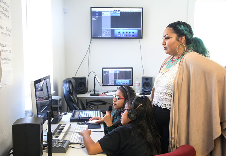 "Program Coordinator Victoria Fajardo teaches a ""Girls on the Mic"" class for organized by Women's Audio Mission at the Unity Council in Oakland's Fruitvale neighborhood on Aug. 29, 2018. Photo: Adelyna Tirado"