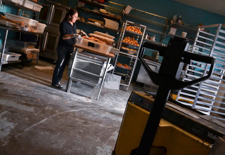 Laura Hernandez, one of La Victoria Bakery's operators, sorts bread in the back kitchen during the last day of business at the bakery, on Tuesday Oct. 9, 2018. Located on 24th and Alabama streets, La Victoria closed its doors after 67 of operating in San Francisco's Mission District. Photo: Mabel Jiménez