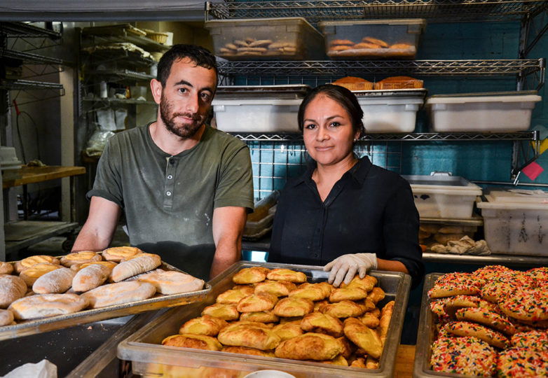 Danny Gabriner and Laura Hernandez, who together operated La Victoria Bakery, sort bread in the back kitchen during the last day of business at the bakery, on Tuesday Oct. 9, 2018. Located on 24th and Alabama streets, La Victoria closed its doors after 67 of operating in San Francisco's Mission District. Photo: Mabel Jiménez