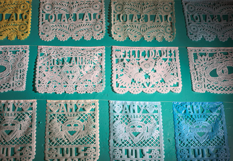 Handmade papel picado hang on the wall inside Casa Bonampak, located in the Mission District, Oct. 12, 2018. Photo: Dane Pollok