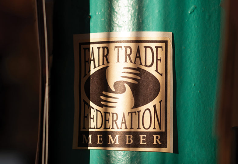 "A ""Fair Trade Member"" poster hangs inside Casa Bonampak, Oct. 12, 2018. Photo: Dane Pollok"