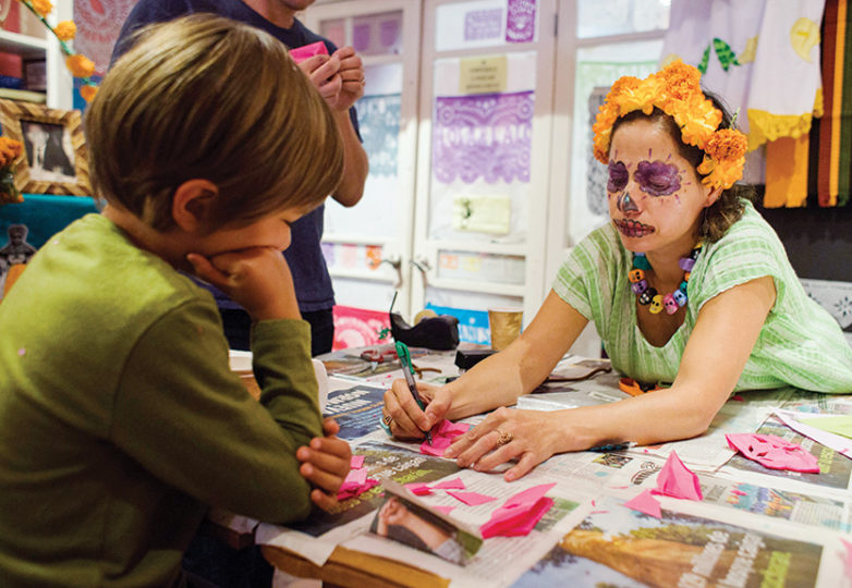 Casa Bonampak owner Nancy Charraga works with children and family members on Oct. 13 during her annual altar building workshop for the upcoming Día de Muertos in San Francisco. Photos: Lara Kaur