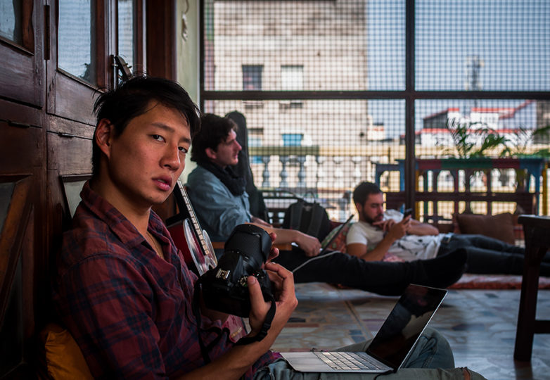 Mike Chen sets up his laptop and camera at a refugee camp in Varanasi, India, after completing a two-month 4000 km solo motorcycle trip across the Pakistani and Tibetan borders of northern India, through the Himalayas of Nepal. Courtesy: Mike Chen